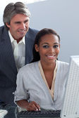 Mature businessman helping his colleague — Stock Photo