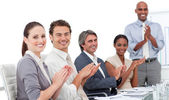 Assertive business clapping a good presentation — Stock Photo