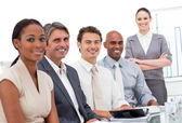 International business team smiling at the camera — Stock Photo