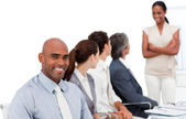 Multi-ethnic business group at a presentation — Stock Photo