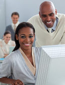 Assertive business partners working at a computer — Stock Photo