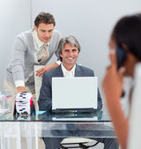 Charismatic businessmen working at a computer together — Stock Photo