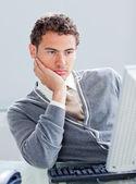 Bored businessman at his desk — Stock Photo