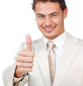 Close-up of a smiling businessman with thumb up — Stock Photo