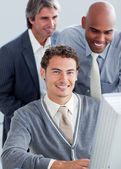 Handsome businessmen working at a computer — Stock Photo