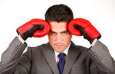 Stressed businessman with boxing gloves — Stock Photo