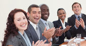 Happy businessteam clapping in a meeting — Stock Photo