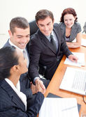 Business team in a meeting shaking hands — Stock Photo