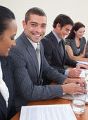 Smiling attractive businessman in a meeting — Stock Photo