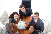High view of happy business holding a globe. Global busin — Stock fotografie