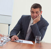 Attractive businessman bored in a meeting — Stock Photo