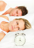 Unhappy couple lying on their bed — Stock Photo