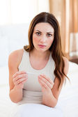 Upset woman finding out results of a pregancy test — Stock Photo
