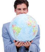 Portrait of an ambitious man holding a terrestrial globe — Stock Photo