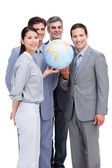 Successful businessteam looking at a terrestrial globe — Stock Photo