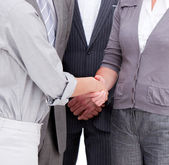 Close-up of a positive businessteam closing a deal — Stock Photo