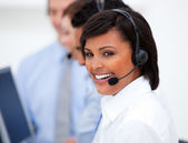 Close-up of an ethnic customer service agent and her team — Stock Photo