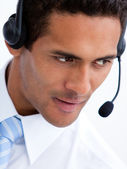 Portrait of a positive businessman with headset on — Stock Photo