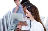Smiling business team working in a call center — Stock Photo