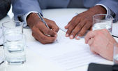 Close-up of ambitious business closing a deal — Stock Photo