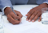 Close-up of ambitious business man signing a contract — Stock Photo