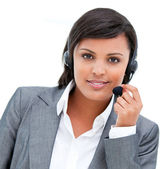 Portrait of an ethnic customer agent at work — Stock Photo