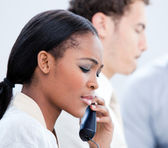 Concentrated Afro-American businesswoman talking on phone — Stock Photo