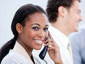 Smiling Afro-American businesswoman talking on phone — Stock Photo