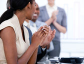 Happy business team applauding in a meeting — Stock Photo