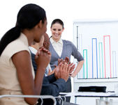 Jolly business team applauding in a meeting — Stock Photo