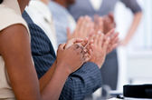 Ambitious business team applauding in a meeting — Stock Photo