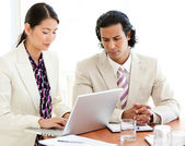 Concentrated business working at a laptop — Stock Photo