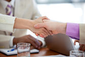 Close-up of two business shaking hands — Stock Photo