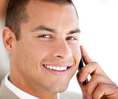 Handsome businessman talking on phone — Stock Photo