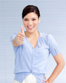 Happy businesswoman with a thumb up — Stock Photo