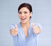 Successful businesswoman with thumbs up — Stock Photo