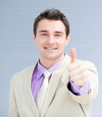 Positive businessman with a thumb up — Stock Photo