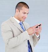 Attractive businessman sending a text — Stock Photo