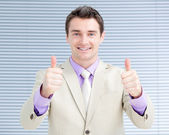 Successful businessman with thumbs up — Stock Photo
