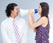 Furious businesswoman yelling through a megaphone — Stock Photo
