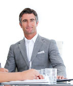 Portrait of a charming businessman in a meeting — Stock Photo