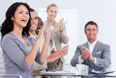 Cheerful business applauding in a meeting — Stock fotografie