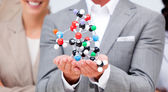 Close-up of a businessman holding a molecule — Stock Photo