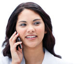 Portrait of a charismatic businesswoman talking on phone — Stock Photo