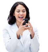 Portrait of a happy businesswoman sending a text — Stock Photo