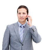 Portrait of an assertive businessman on phone — Stock Photo