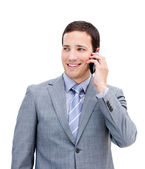 Portrait of a charismatic businessman on phone — Stock Photo