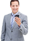 Portrait of a victorious businessman looking at his phone — Stock Photo