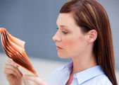 Serious businesswoman reading newspaper — Stock Photo