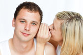 Woman whispering a man something important — Stock Photo